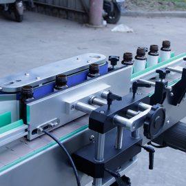 Λεπτομέρειες αυτόματης ετικέτας αυτοκόλλητων ετικεττών κάθετης στρογγυλής φιάλης